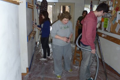 Middlebury students at work painting common house