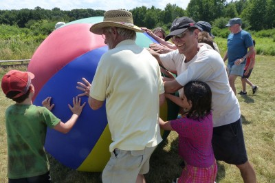 "EcoVillage residents play with Earth Ball"". Photo credit: Jim Bosjolie"