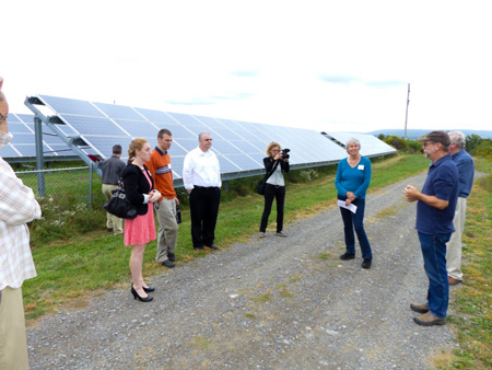Jeff Gilmore explains the 50kW solar array. Photo: Jim Bosjolie